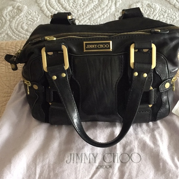 72a0824e1cd Jimmy Choo Handbags - Authentic black leather Jimmy Choo Purse.
